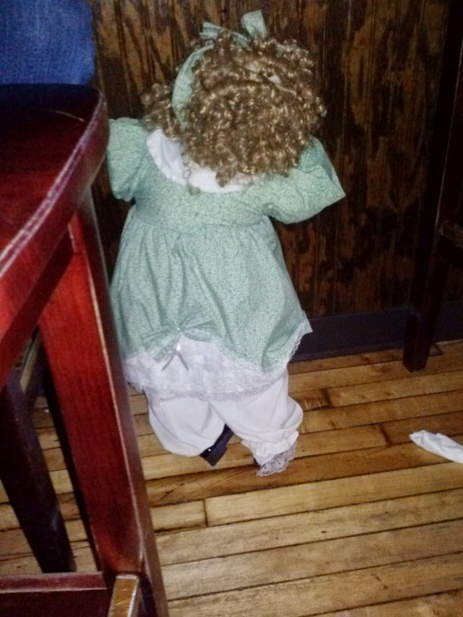 Penelope Anne hiding under a table